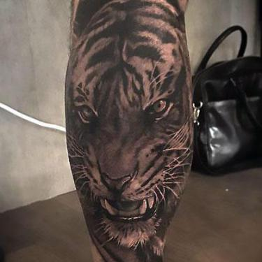Black and Gray Tiger on Calf Tattoo