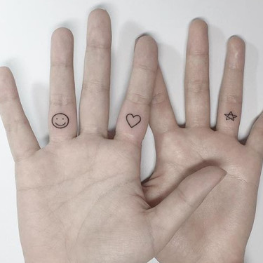 Smiley, Heart, and Star on Fingers Tattoo