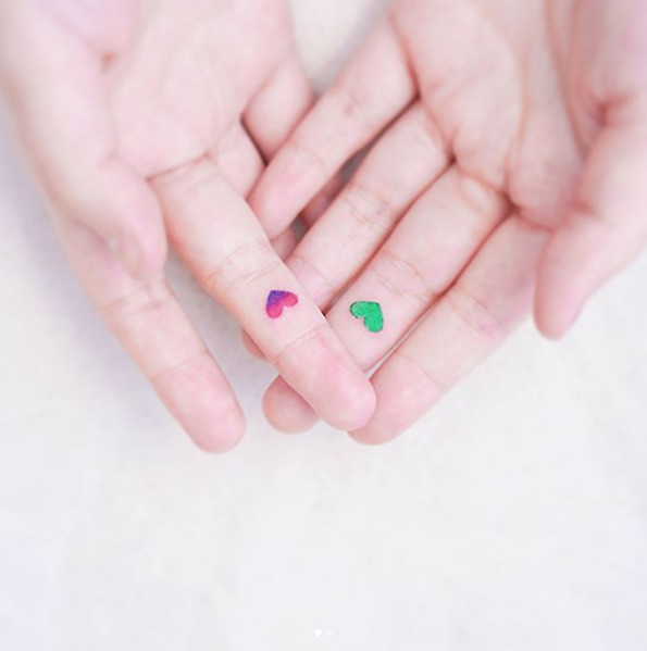 Colored Mini Hearts Tattoo Idea