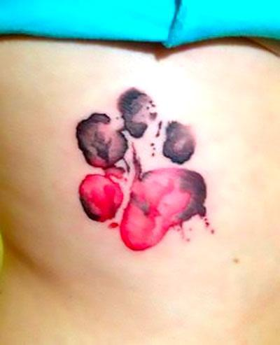 Black and Red Puppy Paw Print Tattoo Idea
