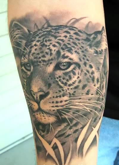 Black and White Leopard Face Tattoo Idea