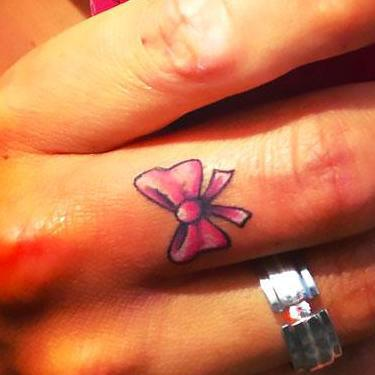 Bow on Middle Finger Tattoo