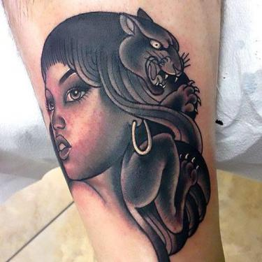 Black Panther Head in Hairs Tattoo