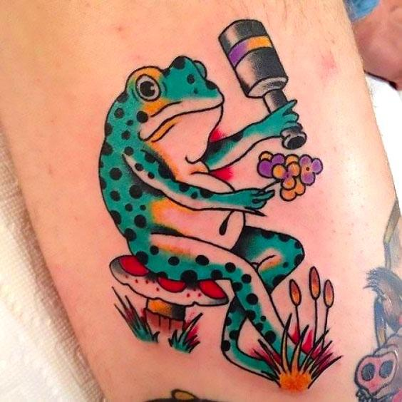 Cartoon Frog With Flowers Tattoo Idea