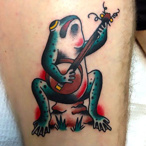 Cartoon Musician Frog Tattoo Idea