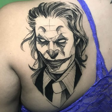 Joker Geometric Face Tattoo