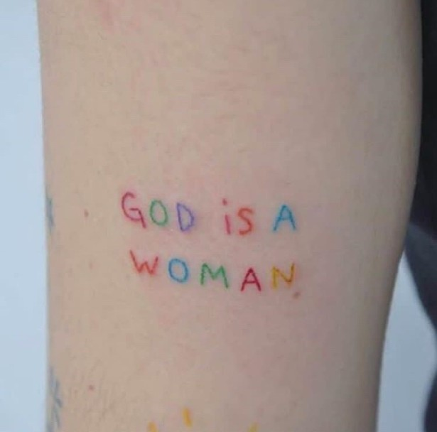 Got Is A Woman Tattoo Idea