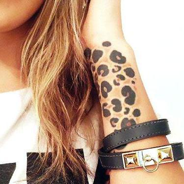Cheetah Print on Wrist Tattoo