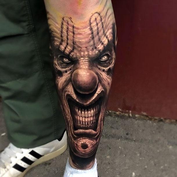 Clown Face on Shin Tattoo Idea