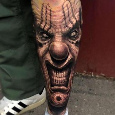 Clown Face on Shin Tattoo