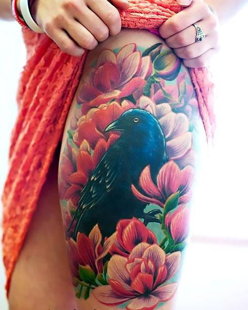 Colorful Blackbird on Thigh Tattoo Idea