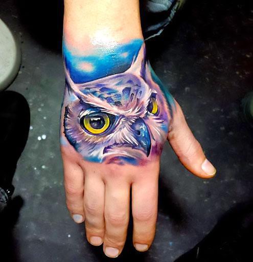 Colorful Owl on Hand Tattoo Idea