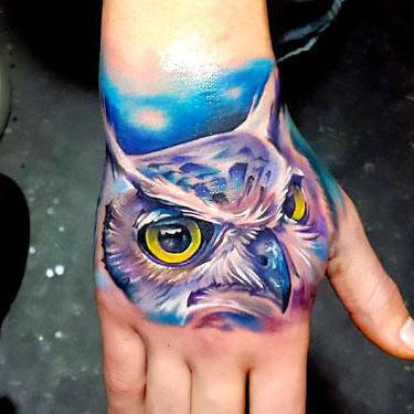 Colorful Owl on Hand Tattoo
