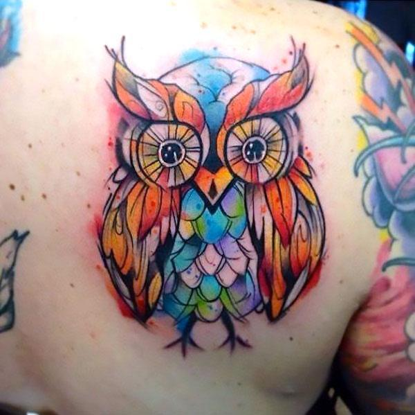 Colorful Surreal Owl Tattoo Idea