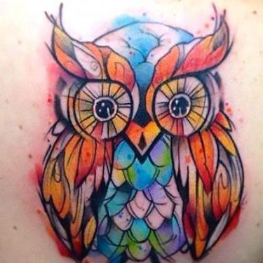 Colorful Surreal Owl Tattoo