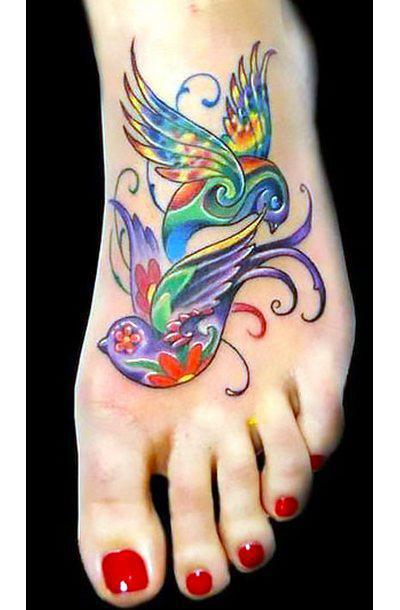 Colorful Swallows on Foot Tattoo Idea