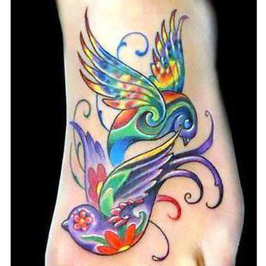 Colorful Swallows on Foot Tattoo