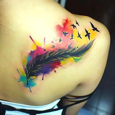 Colorful Watercolor Feather Tattoo