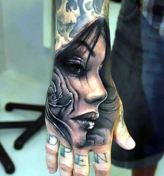 Cool Face on Hand Tattoo Idea