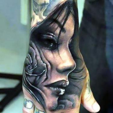 Cool Face on Hand Tattoo