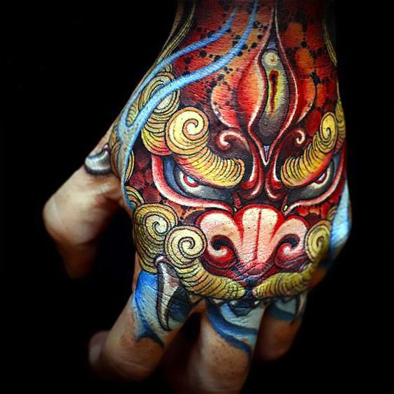 Colorful Foo Dog on Hand Tattoo Idea