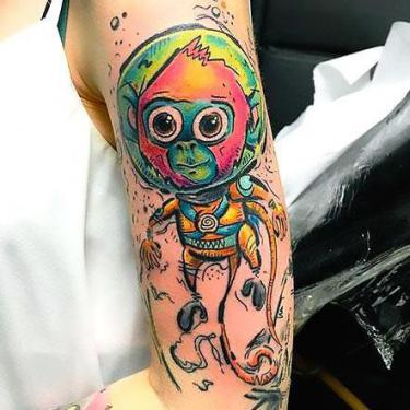 Colorful Space Monkey Tattoo