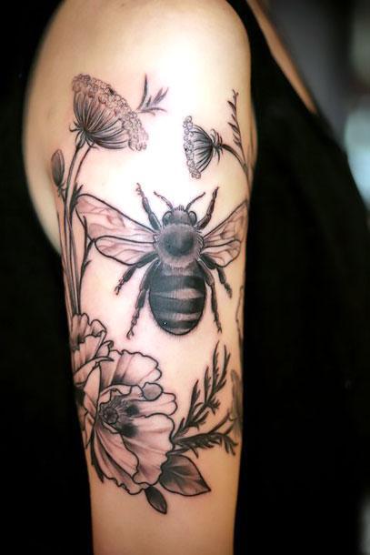 Flowers Around Bee Tattoo Idea
