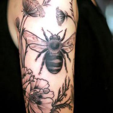 Flowers Around Bee Tattoo