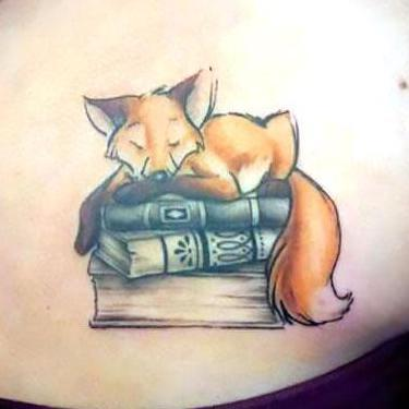 Fox Sleeping on The Books Tattoo