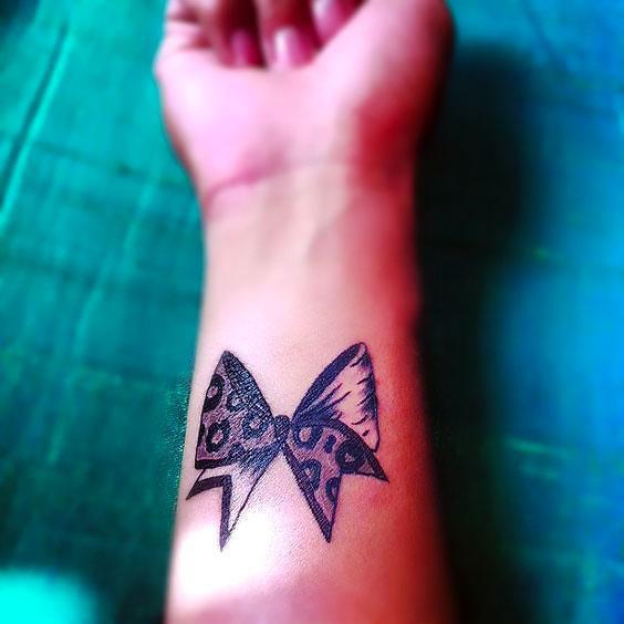 Half leopard Bow Tattoo Idea