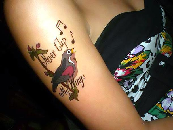 Cool Music Bird Tattoo Idea