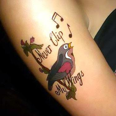 Cool Music Bird Tattoo