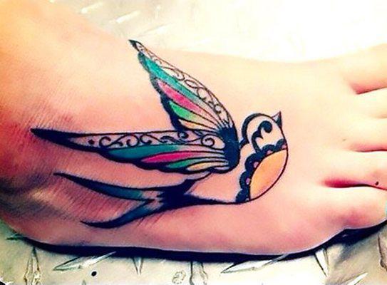 Cool Swallow on Foot Tattoo Idea