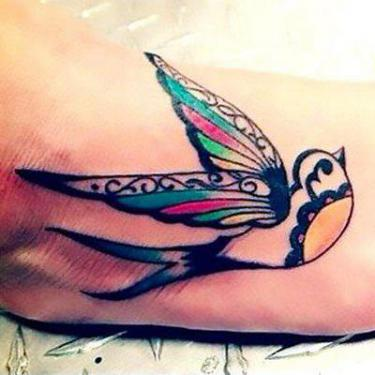 Cool Swallow on Foot Tattoo