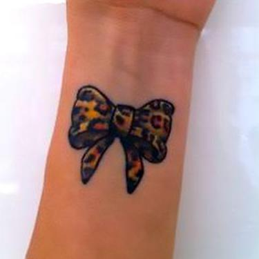 Leopard Bow on Wrist Tattoo