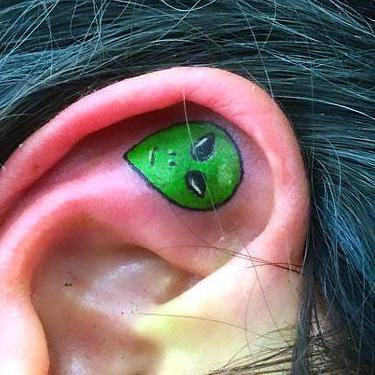 Alien on Inner Ear Tattoo