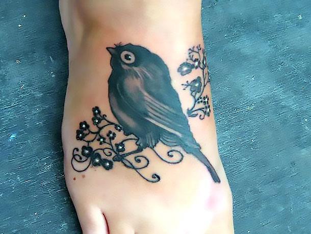 Cute Blackbird Nestling on Foor Tattoo Idea