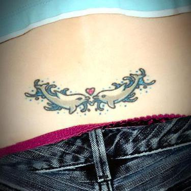 Cute Dolphins on Lower Back Tattoo