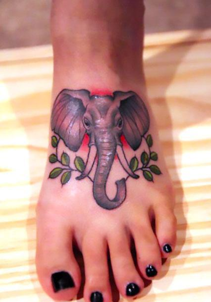 Cute Elephant on Foot Tattoo Idea