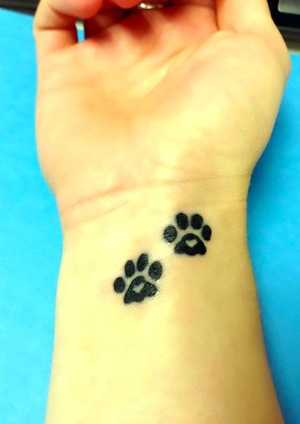 Puppy Paw Prints With Hearts Tattoo Idea
