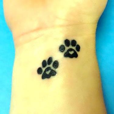 Puppy Paw Prints With Hearts Tattoo