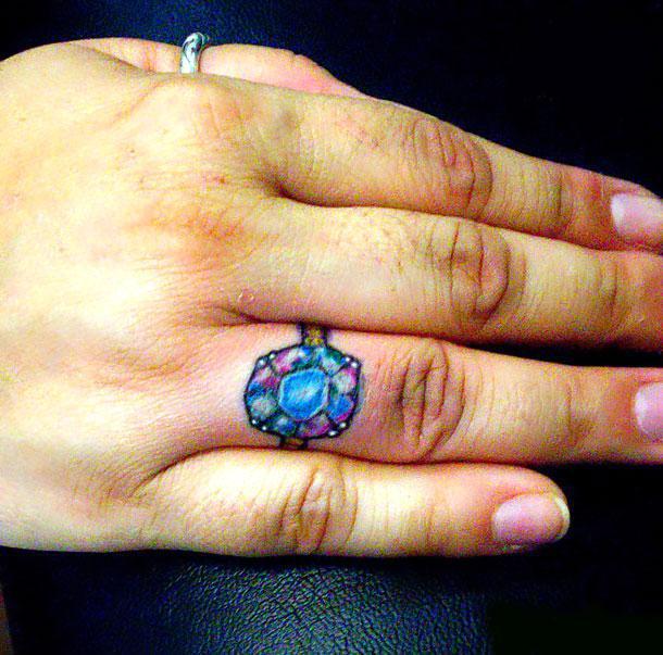Diamond on Ring Finger Tattoo Idea
