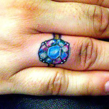 Diamond on Ring Finger Tattoo