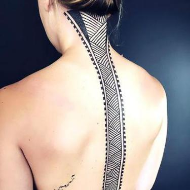 Amazing Lines on Spine Tattoo