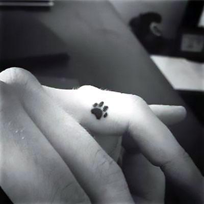 Tiny Puppy Paw Print Tattoo Idea