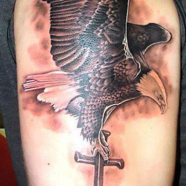 Eagle Carrying Cross Tattoo