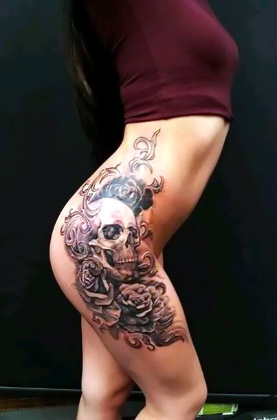 Girly Skull on Hip Tattoo Idea
