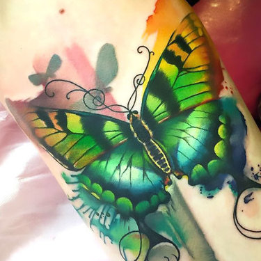 Green Butterfly on Forearm Tattoo