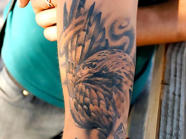 Hawk on Bicep Tattoo Idea