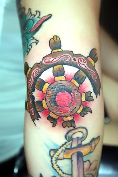Helm on Elbow Tattoo Idea